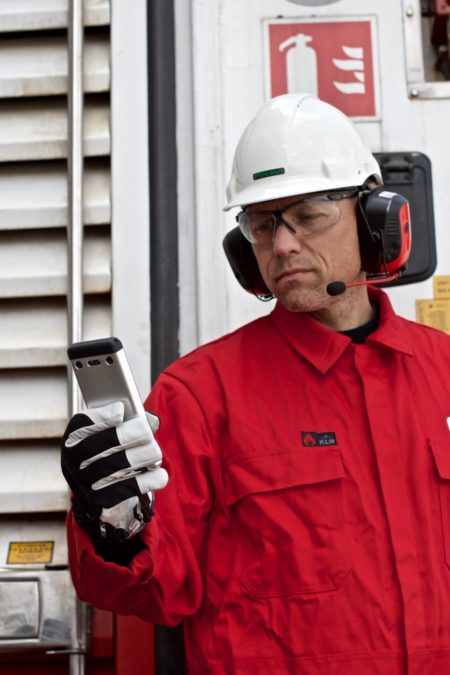 Bartec Gravity X Intrinsically Safe Camera in use man holding witih red coat on