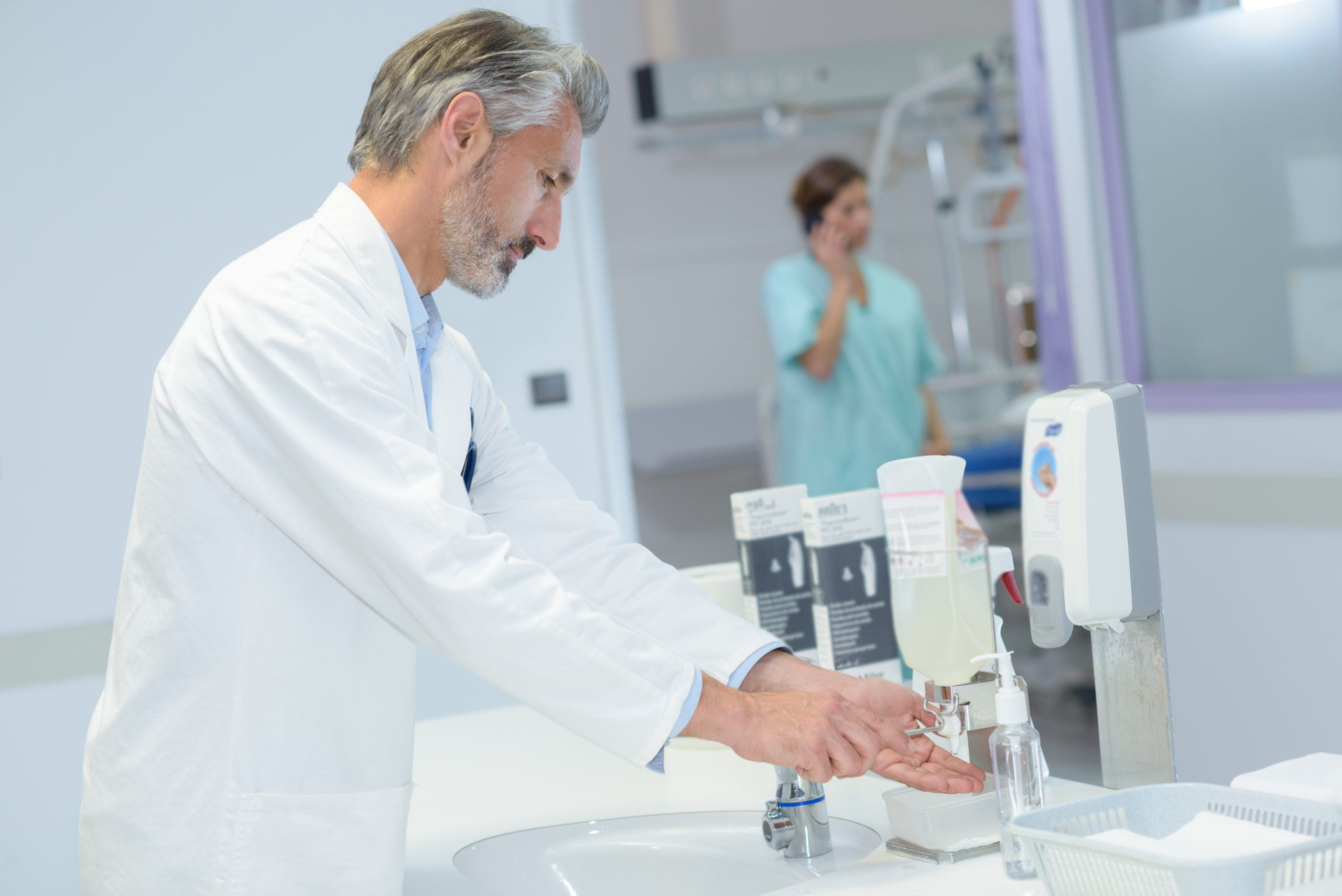 Doctor sanitising hands
