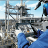 Intrinsically Safe Tablet Agile X IS Bartec Man Holding Agile IS Tablet